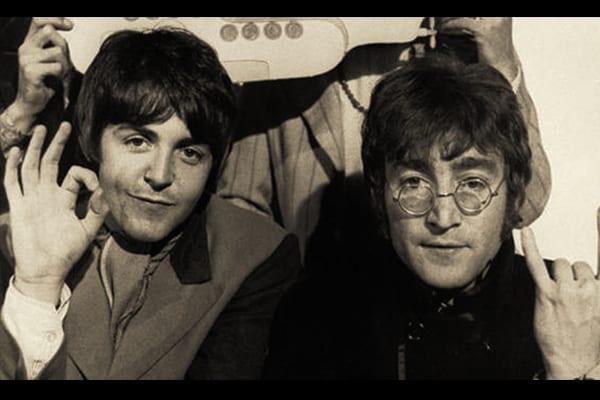 John Lennon being introduced to Paul McCartney